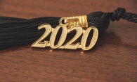 The tassel of a Class of 2020 graduation cap.