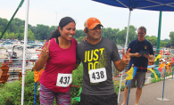 Two people participate in the Rotary Club of White Bear Lake's Strive scholarship run.