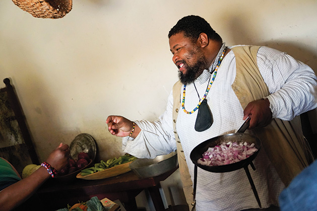 Michael Twitty cooks food at Fort Snelling.