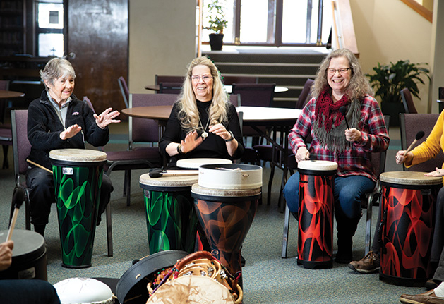 A circle of seniors drum at HealthRHYTHMS at White Bear Lake's Redeemer Lutheran Church
