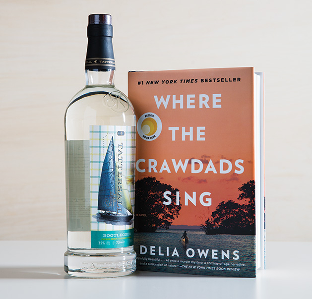 "A bottle of Tattersall Bootlegger, a spirit featuring distilled lime and lemon peels, sits next to ""Where the Crawdads Sing"" by Delia Owens."