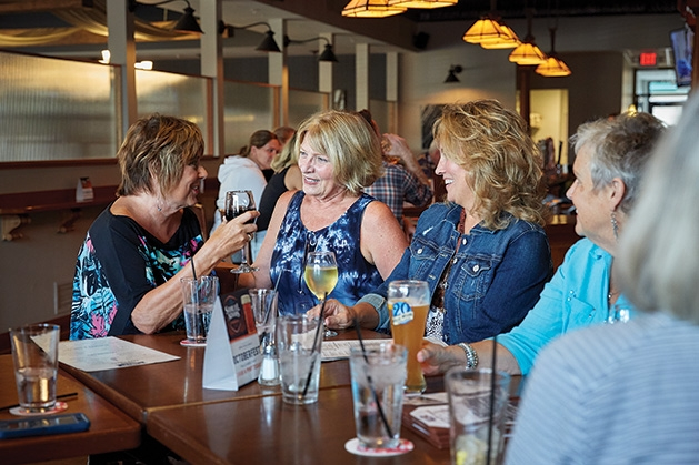 Members of the White Bear Lake Social Meetup enjoy drinks at happy hour.