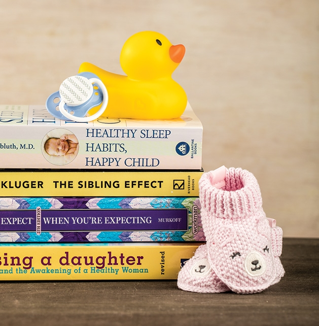 A stack of parenting books from Lake Country Booksellers.