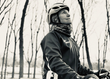 """P.O.W: Pastor's Other Wife"" author Rebecca Fjelland Davis sits on her bicycle"