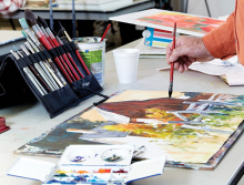 Artist Frank Zeller paints a watercolor at the White Bear Center for the Arts