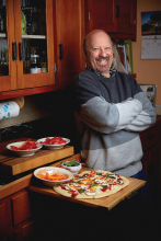 Chef Lee Wolfson with a pizza.
