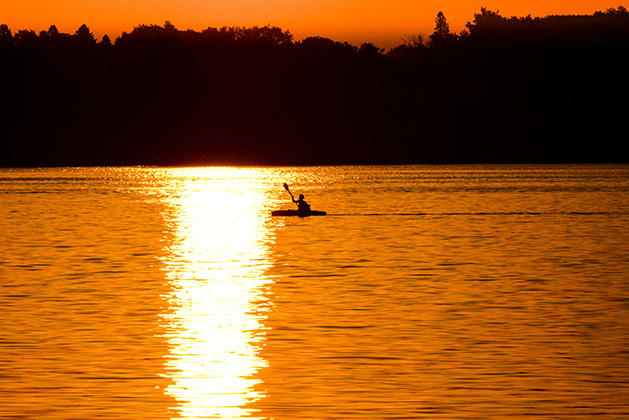 A kayaker paddles on White Bear Lake