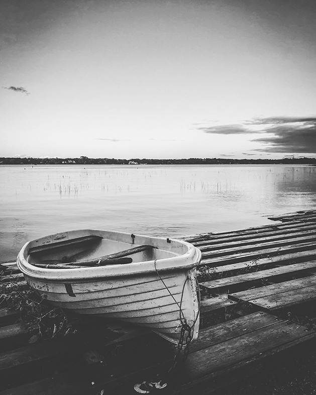 A rowboat on the shore of White Bear Lake