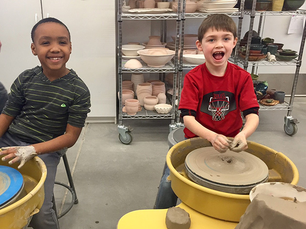 Two kids at a pottery class at White Bear Center for the Arts