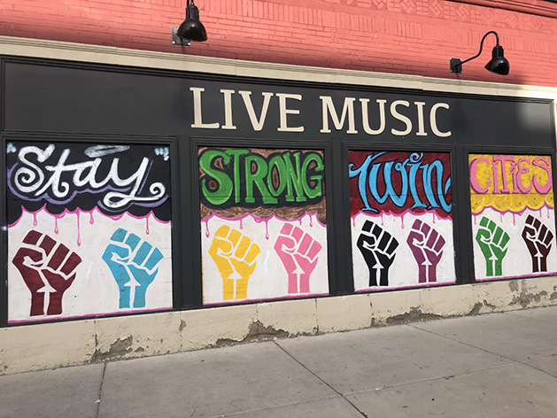"A mural that reads ""Stay Strong Twin Cities."""